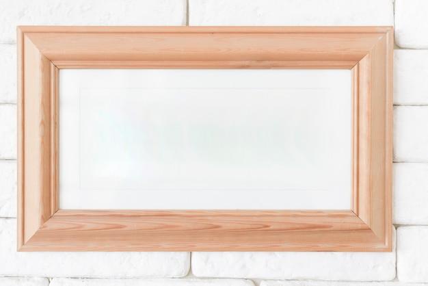 Close-up ramka na zdjęcia na ścianie z cegły Darmowe Zdjęcia