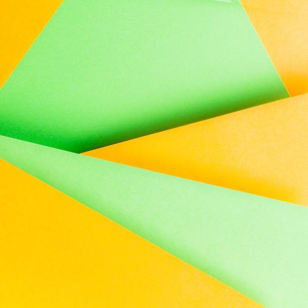 Close-up z żółtym i zielonym tle papieru Darmowe Zdjęcia