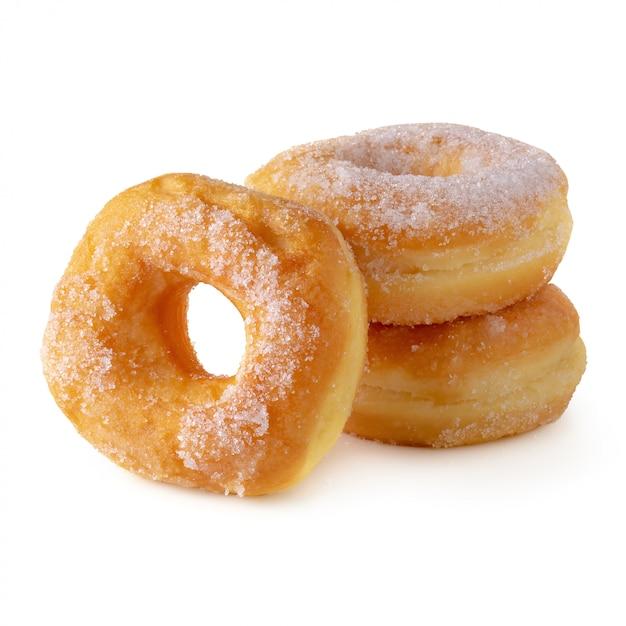 Cukierkowe Pączki Odizolowywający Nad Białym Tłem Premium Zdjęcia