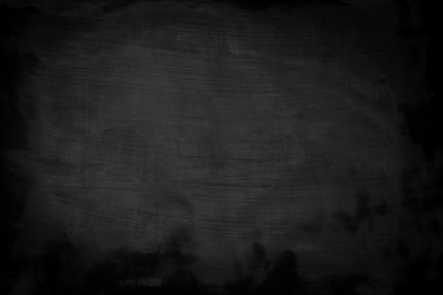 Czarna grunge tekstura z copyspace. streszczenie kreda przetarł na tablicy. Premium Zdjęcia