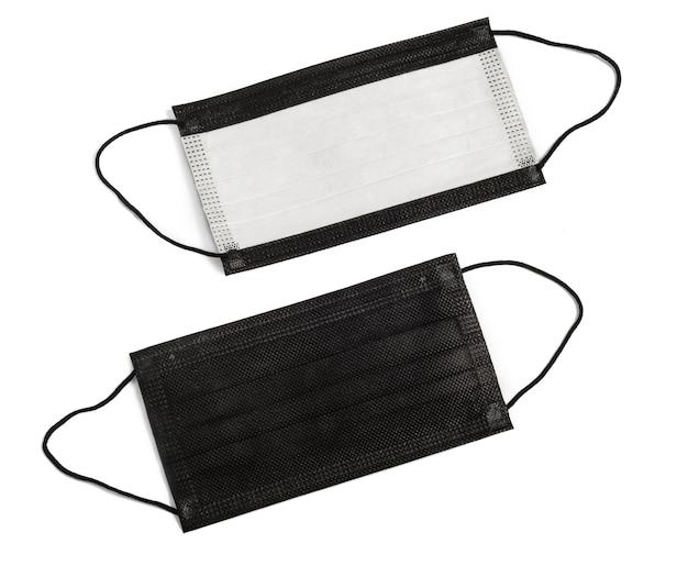 Czarna Medyczna Jednorazowa Maska Ochronna Dwa Kawałki Na Białym Tle. Nikt Premium Zdjęcia