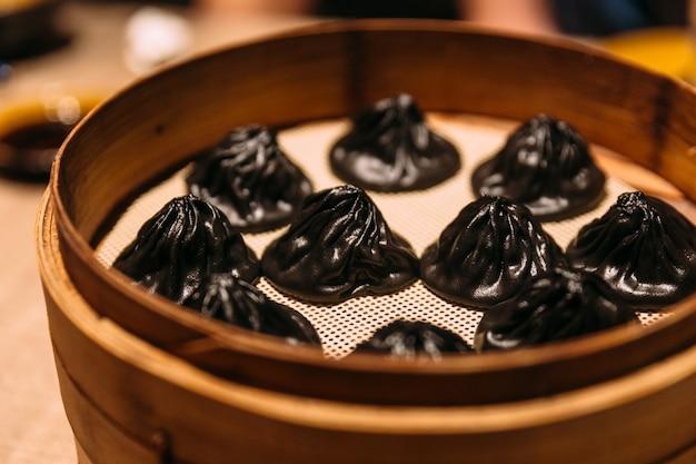 Czarna Trufla Xiao Long Bao (chińska Kluska Zupy). Premium Zdjęcia