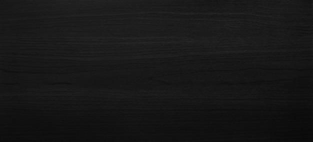 Czarny drewniany tekstury tło z abstrakta wzoru powierzchnią. Premium Zdjęcia
