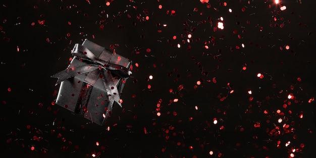 Czarny Prezent Z Czerwonym Brokatem Na Czarnym Tle Premium Zdjęcia