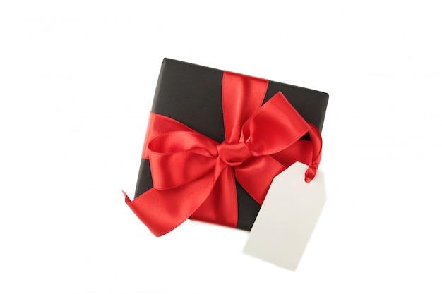 Czarny prezenta pudełko z sprzedaży etykietką odizolowywającą na bielu Premium Zdjęcia