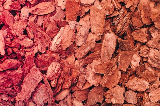 Czerwony Brązowy Wiór Drzewny Kora Tekstura Tło. Premium Zdjęcia