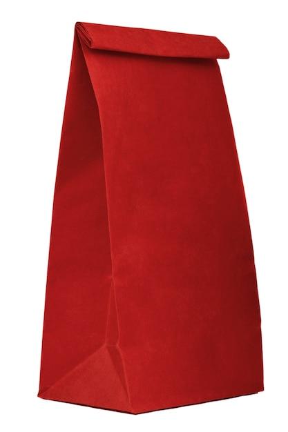 Czerwony papierowy torba na zakupy z przestrzenią odizolowywającą na białym backgro Premium Zdjęcia