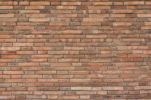 Czerwony ściana z cegieł tekstury grunge tło dla wewnętrznego projekta Premium Zdjęcia