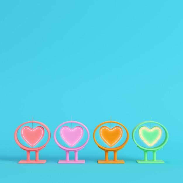 Cztery Kolorowe Neonowe Serce W Ramce Na Jasnym Niebieskim Tle Premium Zdjęcia