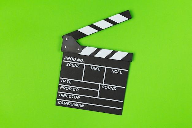 Deska grzechotka filmu na zielony widok z góry Premium Zdjęcia