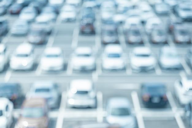 Disfocut tła parkingu samochodowego Premium Zdjęcia