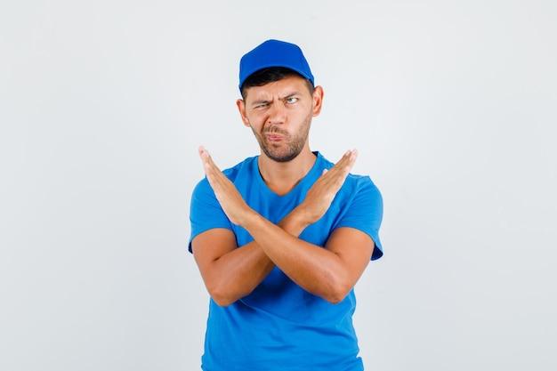 Dostawczyni Zakrzywione Usta Z Gestem Odmowy W Niebieskiej Koszulce Darmowe Zdjęcia