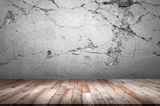 Drewniana podłoga i ściana cementu. Premium Zdjęcia