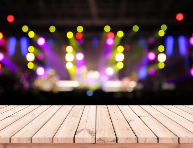 Drewno Stołowa Lub Drewniana Podłoga Z Abstrakcjonistyczną Sceną Zaświecamy Bokeh Tło Dla Produktu Pokazu Premium Zdjęcia
