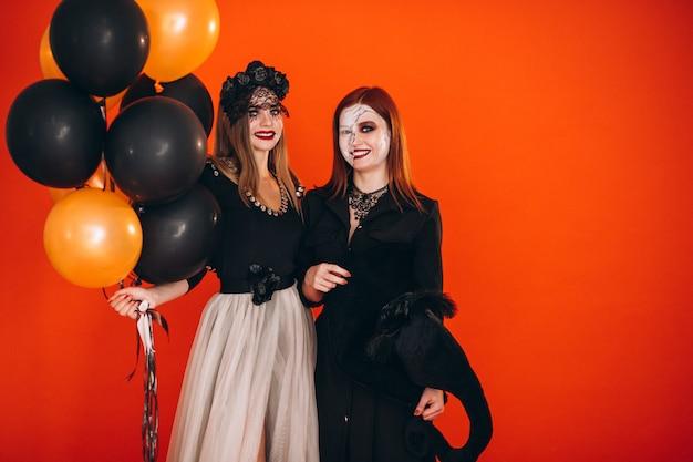 Dwie dziewczyny w kostiumach na halloween Darmowe Zdjęcia