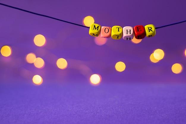 Dzień matki napis z drewnianych kostek Premium Zdjęcia