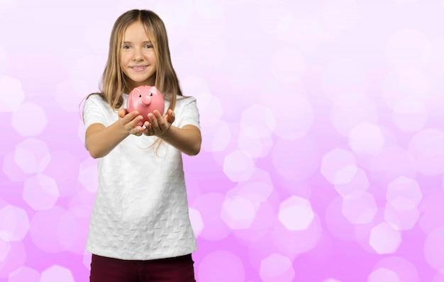Dziewczyna z skarbonka Premium Zdjęcia