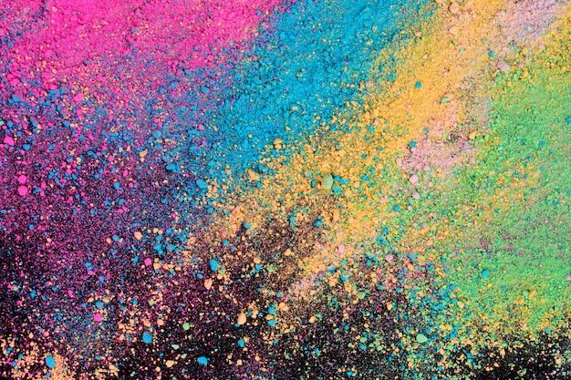 Eksplozja proszku barwnego pigmentu na czarnym tle. Premium Zdjęcia