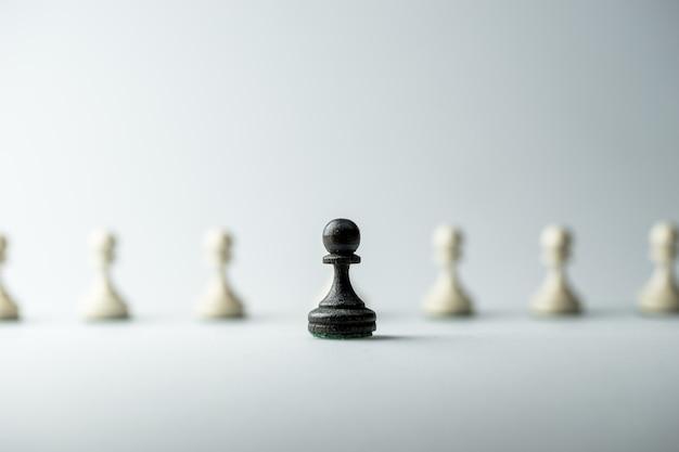 Figura szachowa, strategia biznesowa, przywództwo, zespół i sukces Premium Zdjęcia
