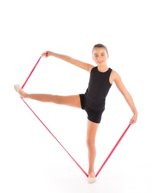 Fitness gumowy zespół oporowy dziecko dziewczynka ćwiczenia Premium Zdjęcia