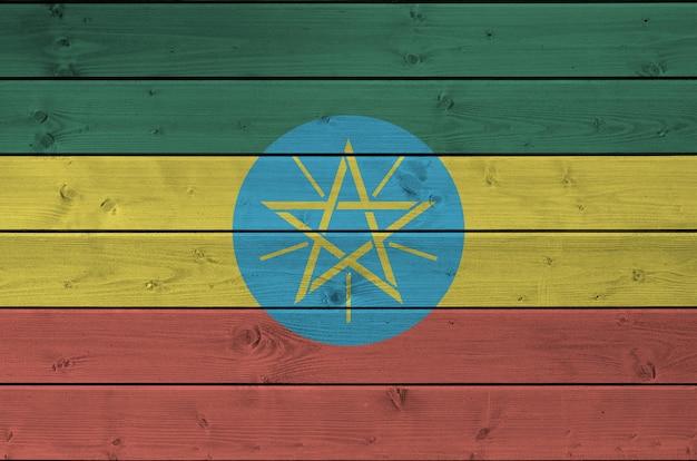 Flaga Etiopii Przedstawione W Jasnych Kolorach Farb Na Stare Drewniane Tła Premium Zdjęcia