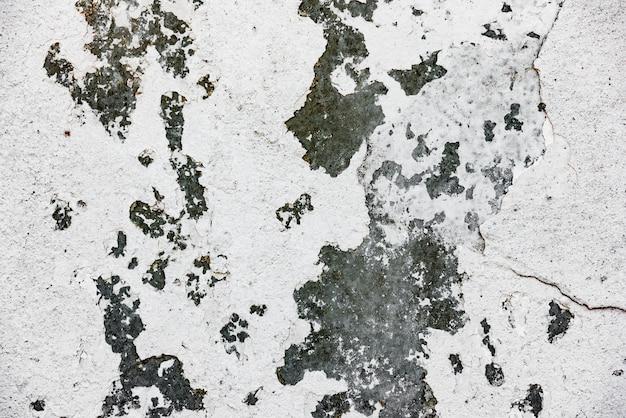 Fragment ściany Z Rysami I Pęknięciami W Tle Premium Zdjęcia
