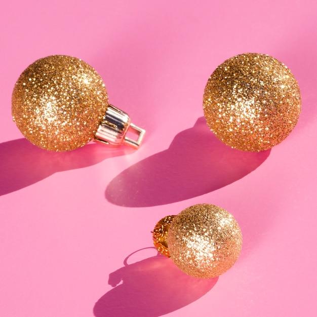 Glitter globusy na różowym tle Darmowe Zdjęcia