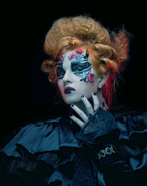 Gotycka czarownica z makijażem halloween Premium Zdjęcia