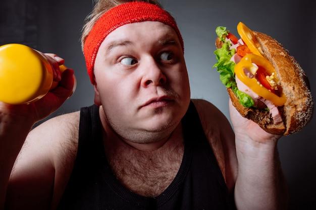 Gruby Wybór Między Sportem A Fast Foodem Premium Zdjęcia