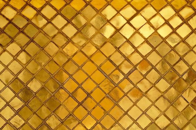 Horyzontalna tekstura złoty mozaiki ściany tło Premium Zdjęcia