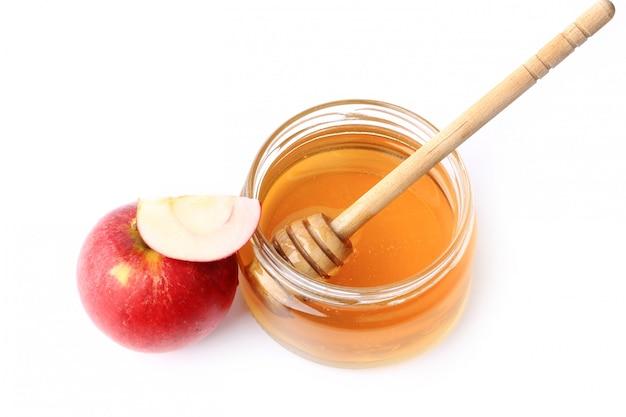 Jabłko Z Miodem Odizolowywającym Na Białym Tle Premium Zdjęcia