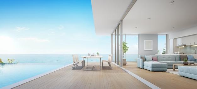 Jadalnia Na świeżym Powietrzu I Widok Na Morze Salon Obok Kuchni Luksusowego Domku Na Plaży Premium Zdjęcia