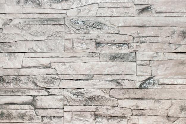 Jasnoszara tekstura kamiennej ściany. Premium Zdjęcia