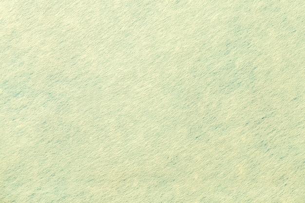 Jasnozielone Tło Z Filcu. Tekstura Wełnianej Tkaniny Premium Zdjęcia