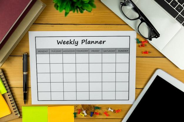 Kalendarz tygodniowy plan prowadzenie działalności gospodarczej lub działalność za tydzień. Premium Zdjęcia