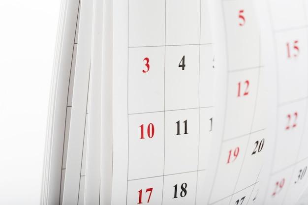 Kalendarzowe strony zamykają w górę biznesowego czasu pojęcia Premium Zdjęcia