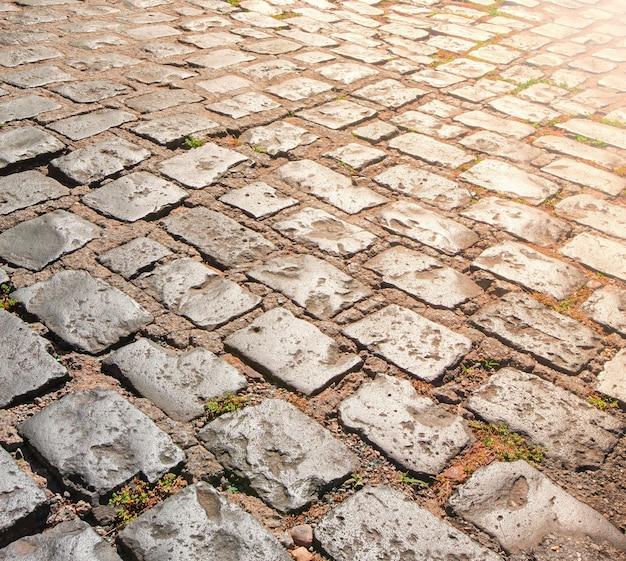 Kamienna Chodnik Tekstura Ze światłem Słonecznym Premium Zdjęcia