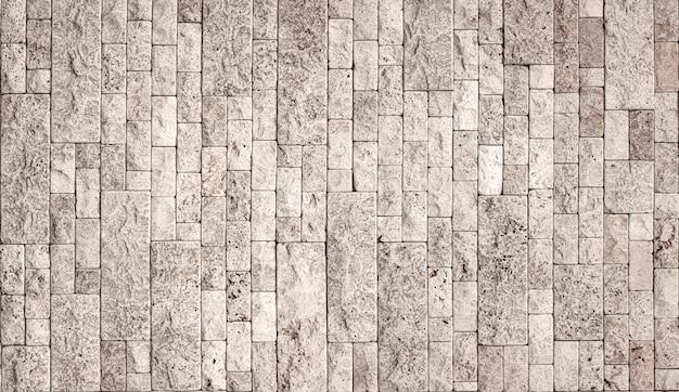 Kamienna ściana Tekstur, Kwadratowa żółta Płytka Trawertynowa. Element Projektu Lub Tło. Premium Zdjęcia