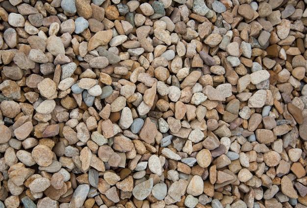 Kamienni Otoczaki Brown I Szary żwir Tekstury Tła Tło Dla Dekoraci. Premium Zdjęcia