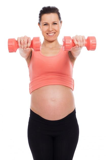 Kobieta W Ciąży Z Hantlami Darmowe Zdjęcia