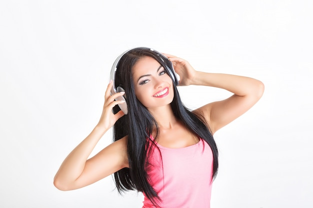 Kobieta ze słuchawkami Premium Zdjęcia