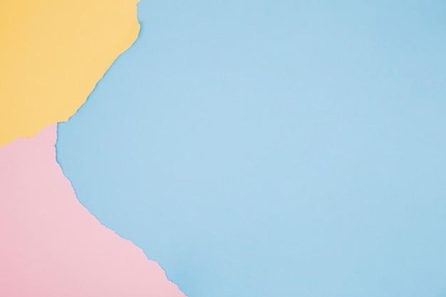 Kolorowy minimalistyczny tło z papierem Darmowe Zdjęcia