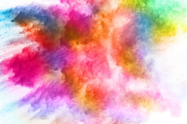Kolorowy prochowy wybuch na białym tle. Premium Zdjęcia
