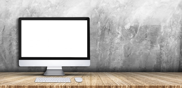 Komputer Stacjonarny, Klawiatura, Mysz Na Drewnianej Deski Blat Stołu Szarego Grunge Betonowej ściany Tle Premium Zdjęcia