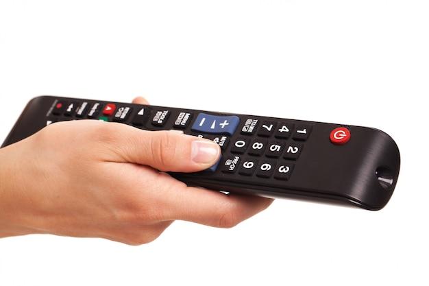 Konsola telewizyjna w kobiecej dłoni Darmowe Zdjęcia