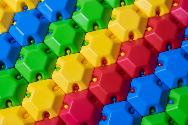 Konstruktor Kolorowych Puzzli Z Tworzywa Sztucznego. Może Być Używany Jako Kolorowe Tło Premium Zdjęcia