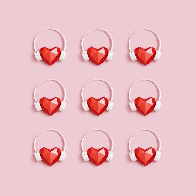 Kreatywne Mieszkanie Leżało Z Czerwonym Sercem Z Papieru W Białych Słuchawkach. Koncepcja Festiwali Muzycznych, Stacji Radiowych, Melomanów. Premium Zdjęcia