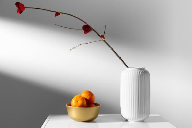 Kwiat W Wazonie I Pomarańczowy Nowy Rok Chiński 2021 Darmowe Zdjęcia