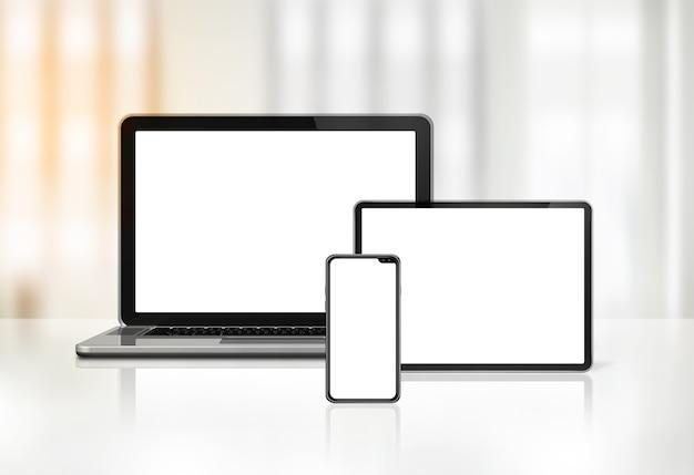 Laptop, Telefon Komórkowy I Cyfrowy Tablet Pc Na Biurku Wnętrza Premium Zdjęcia