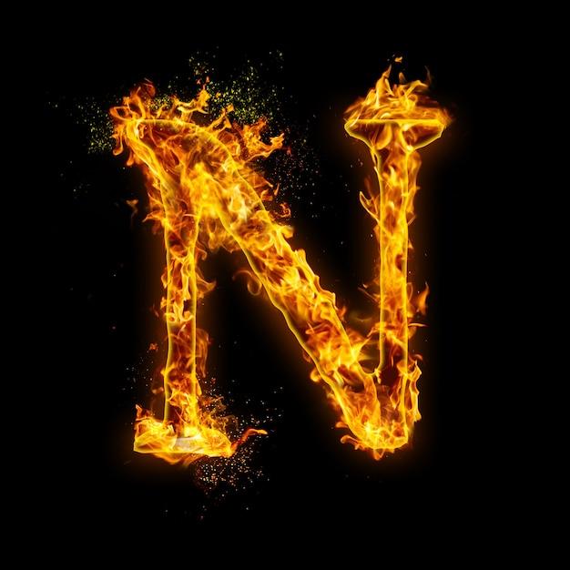 Litera N. Płomienie Ognia Na Czarnym, Realistyczny Efekt Ognia Z Iskrami. Premium Zdjęcia